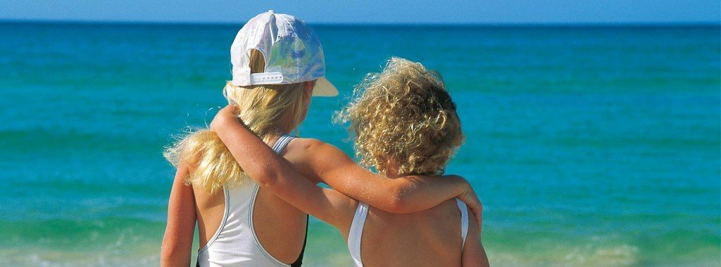 Kids enjoying the beach on their Seventeen Seventy Agnes Water holiday