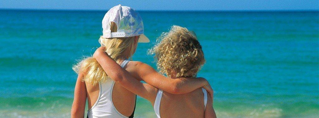 Kids enjoying the beach on their Seventeen Seventy Agnes Water holiday