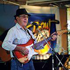 Man playing electric guitar at the festival