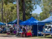 market stalls under the shady trees