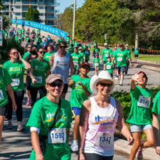 people in green shirts running at the festival